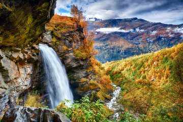 Fotobehang Watervallen Beautifull waterfall in autumn scenery