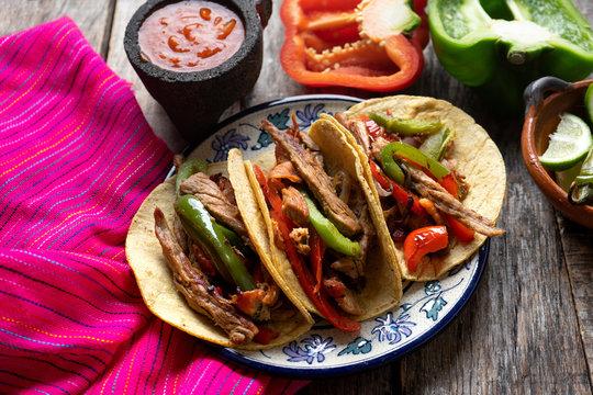 "Tacos of mexican beef fajitas also called ""alambre"""