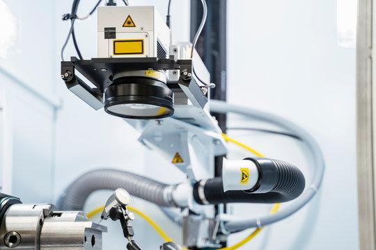 Laser marking system inside modern factory, Stuttgart, Germany