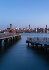 View on Two piers in East river and midtown manhattan in Background ,Sunrise photo with long exposure