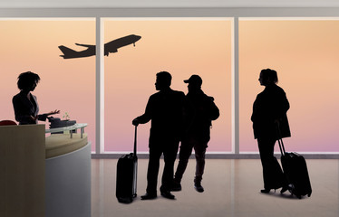 Silhouettes of passengers waiting in line at an airport check in counter with an attendant checking real ID or passport and luggage.