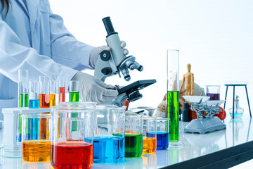 Medical or scientific laboratory researcher performs tests