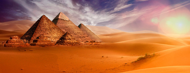 Giseh pyramids in Cairo in Egypt desert sand sun
