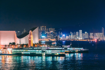 Wall Mural - Night scene of Star Ferry pier, Kowloon Cost, Victoria Harbour, Hong Kong