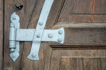 iron fitting on old wooden church door