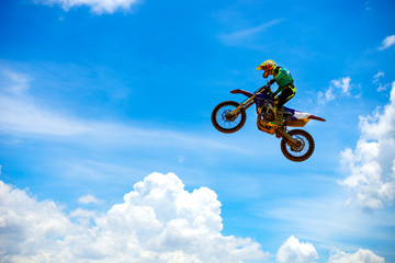 Custom vertical slats sports with your photo Motocross Rider Jump in a blue sky with clouds.Enduro bike rider in action.