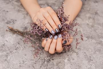 Beautiful grey manicure on hands