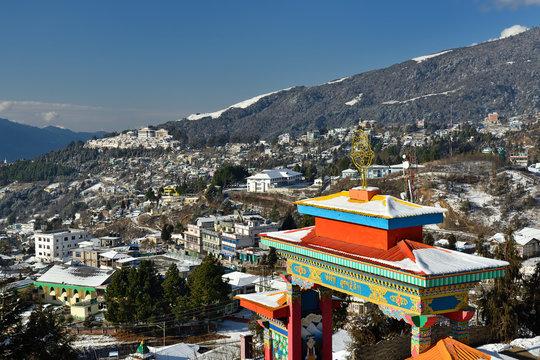 Tawang, Arunachal Pradesh, India - The colour Tibetan entrance Gate and in the distance Tawang Monastery