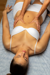 Top view of woman having physiotherapy.