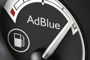 GERMANY - APRIL 12, 2019: AdBlue fuel gauge in truck dashboard - full. AdBlue is a registered the trademark of the German Association of the Automotive Industry (VDA).