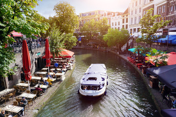 Canal Oudegracht with boat and sidewalk cafes in downtown Utrecht, Netherlands