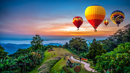 Fotobehang Ballon Hot air balloons adventure in nature over winter mountain in Chiang Mai, Thailand.