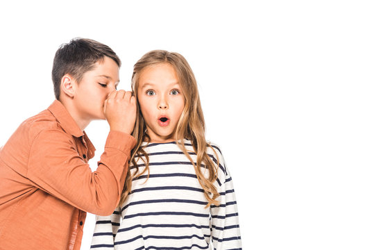 boy telling secret to surprised friend isolated on white