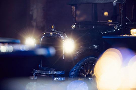 An old black classic retro vintage car on the street. 1920s or 1930s antique mafia car.
