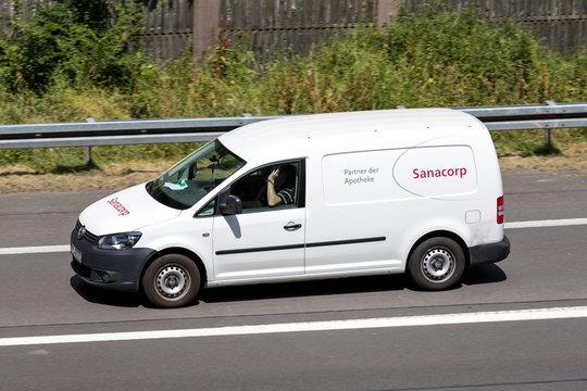 WIEHL, GERMANY - JUNE 30, 2018: Sanacorp van on motorway. The Sanacorp pharmacist cooperative is one of the leading pharmaceutical wholesalers in Germany.