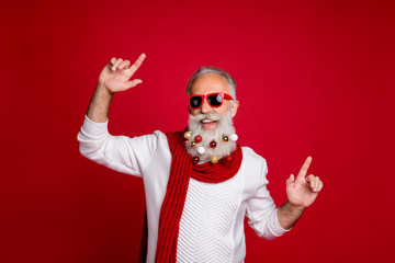 Portrait of cheerful pensioner with eyewear eyeglasses dancing wearing white pullover isolated over red background
