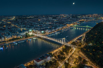 Budapest, Hungary - Aerial drone view of Budapest by night with illuminated Elisabeth and Liberty bridges, River Danube and Gellert Hill at dusk