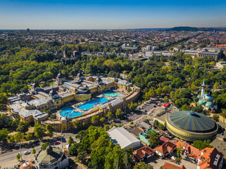 Budapest, Hungary - Aerial panoramic drone view of the famous Szechenyi Thermal Bath and Spa on a sunny summer day. Heroes' Square and Vajdahunyad Castle at background