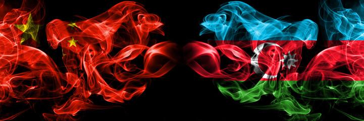 China vs Azerbaijan, Azerbaijani smoke flags placed side by side. Thick colored silky smoke flags of Chinese and Azerbaijan, Azerbaijani
