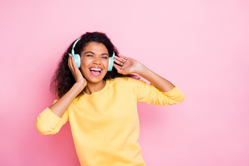 Cool song. I like it. Portrait of funky cheerful crazy african girl have headset listen playlist...