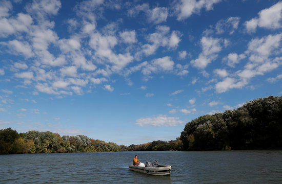 Pardy, 32-year-old, rides his motorboat on River Tisza near Tiszafured