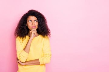 Portrait of focused afro girl think solve her future problems about her weekends try find choice decision solution wear yellow pullover isolated over pastel color background