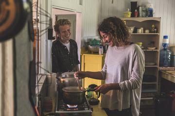 Couple cooking together in a cabin in Canada