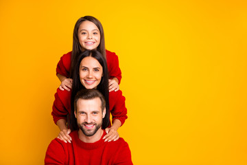 Photo of cheerful funky cute fascinating family forming pyramid creating construction empty space next to mommy daddy day with daughter isolated over vivid color yellow background
