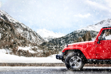 Red winter car with mountains landscape