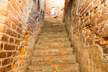 Brick staircase with stairs in old castle corridor