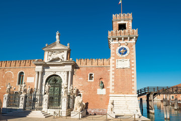 Entrance to Venetian Arsenal with clock and towers. Venice, Italy