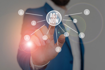 Writing note showing Act Now. Business concept for Having fast response Asking someone to do action Dont delay Male wear formal work suit presenting presentation smart device