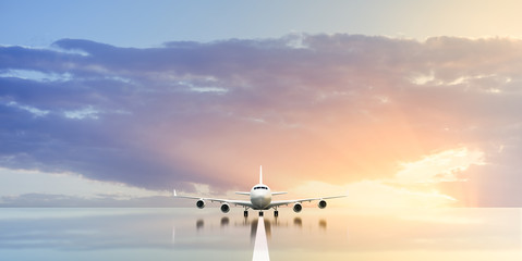 Fototapeta Commercial airplane waiting in the airport at sunset or sunrise. 3D illustration