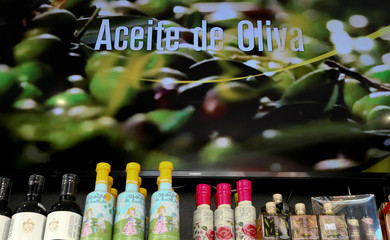 Bottles of extra virgin olive oil are displayed for selling at Fundacion Patrocinio Comunal Olivarero shop in Madrid