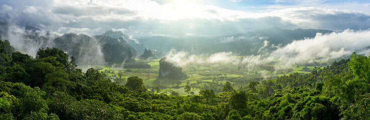 Foto op Plexiglas Donkergrijs Panoramic foggy landscape with mountains in morning