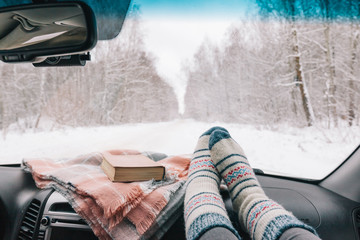 Winter car trip in snowy forest