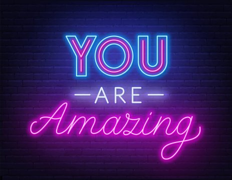 You are amazing neon lettering. Neon sign on brick wall background.