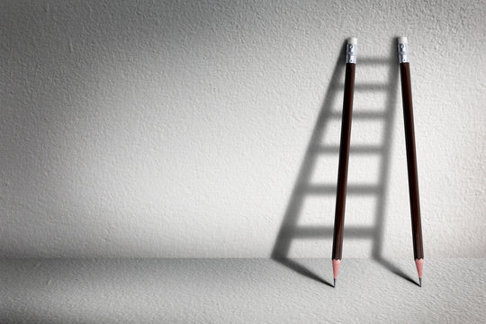 Stairs with pencil for effort and challenge in business to be achievement and successful concept