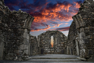Montage in der Fensternische Altes Gebaude Monastic cemetery of Glendalough, Ireland. Famous ancient monastery while sunset in the wicklow mountains with a beautiful graveyard from the 11th century