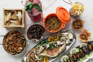 mixed fresh portuguese gourmet seafood set on white table