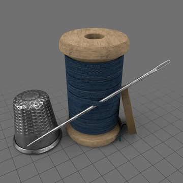 Spool of thread with needle and thimble