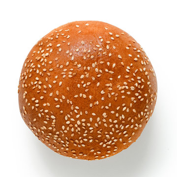Sesame seed hamburger bun isolated on white. Top view.
