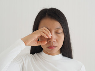 eye socket pain in asian woman cause from the infection of the sinuses cavities or migraines and cluster headaches use for health care concept.