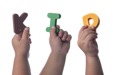 Kids hands holding colorful alphabet letters ,The Word KID