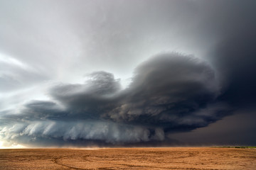 Supercell thunderstorm with dramatic clouds Wall mural