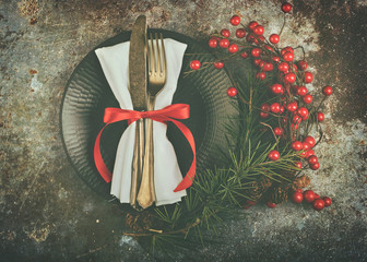 vintage old cutlery served on plate for Christmas Dinner with wreath