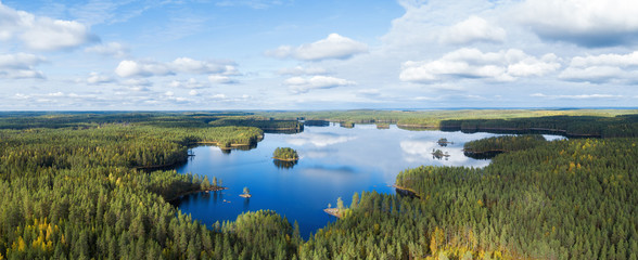 Aerial view on beautiful lake in Finland. Drone photo of Haukkajarvi lake in Helvetinjarvi National park. Lake with islands with forest and beautiful clouds in the sky.