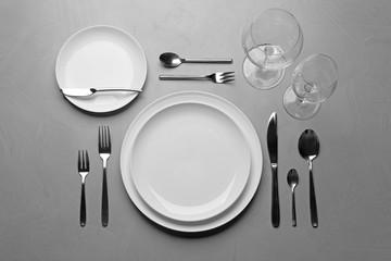 Elegant table setting on grey background, flat lay