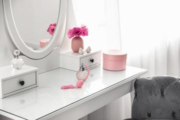 White dressing table near window in light room