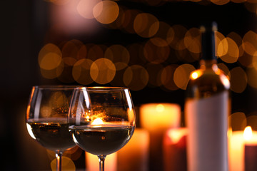 Spoed Foto op Canvas Alcohol Glasses of wine and blurred view of burning candles on background